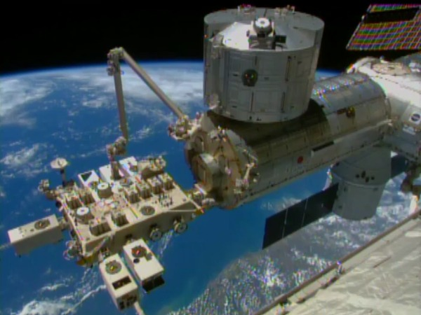 Robotic arms install remote-sensing instrument on ISS