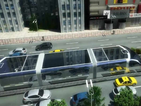 This Futuristic Bus Lets you Drive Your Car Underneath it