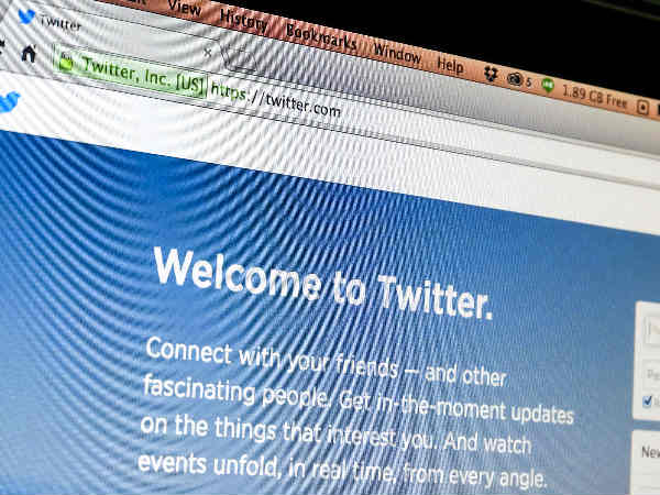 Twitter to free room for links and photos: report