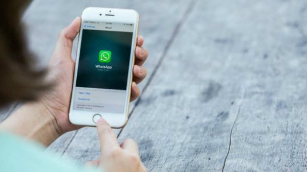 WhatsApp limits message forwarding to five chats globally