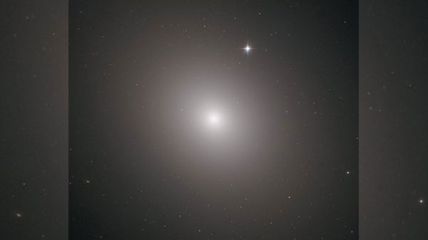 NASA's Hubble telescope snaps massive elliptical galaxy with 200 billion stars