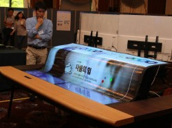 LG unveils the world's first 77-inch flexible OLED display
