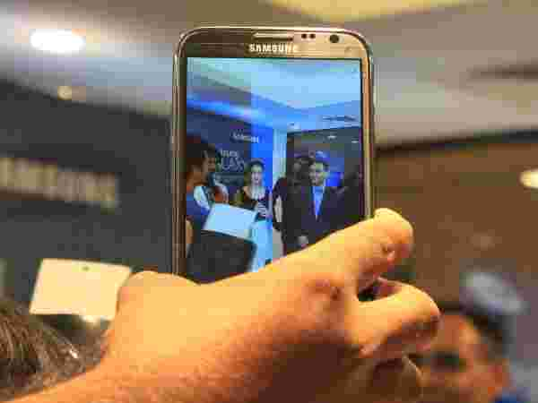 Samsung Galaxy S4 Camera Shoots Genelia D'Souza and Manu Sharma, Director, Samsung Mobile at the Samsung Galaxy S4 launch in Bangalore