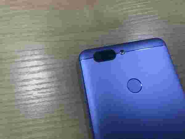 Rear Fingerprint sensor and dual camera setup